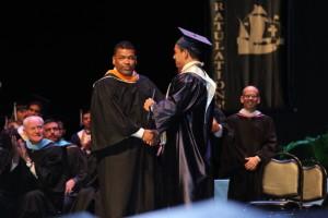 Mr. Roa presents his son Jossan his diploma